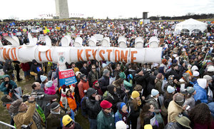 Protesters gather at the National Mall in Washington calling on President Barack Obama to reject the Keystone XL oil pipeline from Canada and to act on climate change.  (AP Photo/Manuel Balce Ceneta)